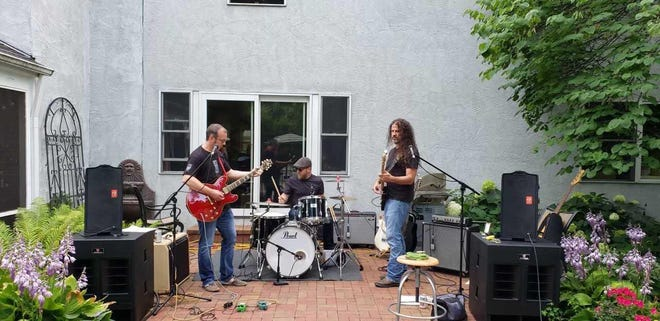 The live incarnation of the Repo Pilots (from left, Sean Woosley, David Murphy and Ben Lamb) rehearse for the band's release show.