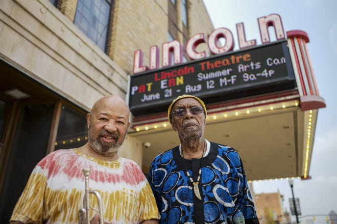 """Jazz musician Arnett Howard, left, and poet Charles """"Is Said"""" Lyons outside the Lincoln Theatre. The pair, along with the late artist Roman Johnson, will be inducted onto the Lincoln's Walk of Fame."""