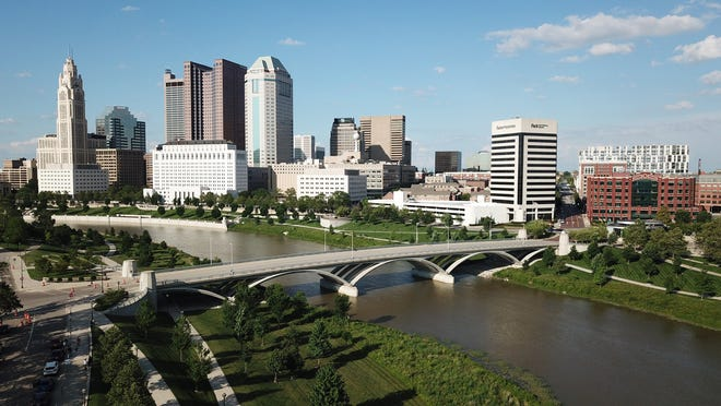 The downtown Columbus skyline features include (from left) the  LeVeque Tower, The Rhodes Tower, , the Huntington building, the Riffe Center, and the Town Street Bridge over the Scioto River.