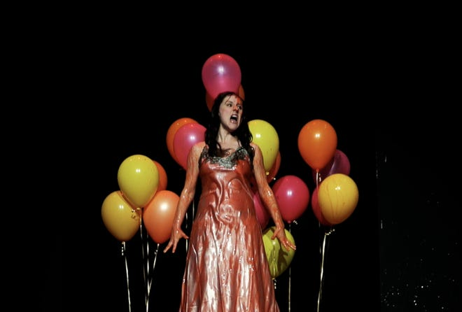 """Eli Brickey lashes back at her peers as Carrie in Columbus Immersive Theater's production of """"Carrie the Musical."""""""
