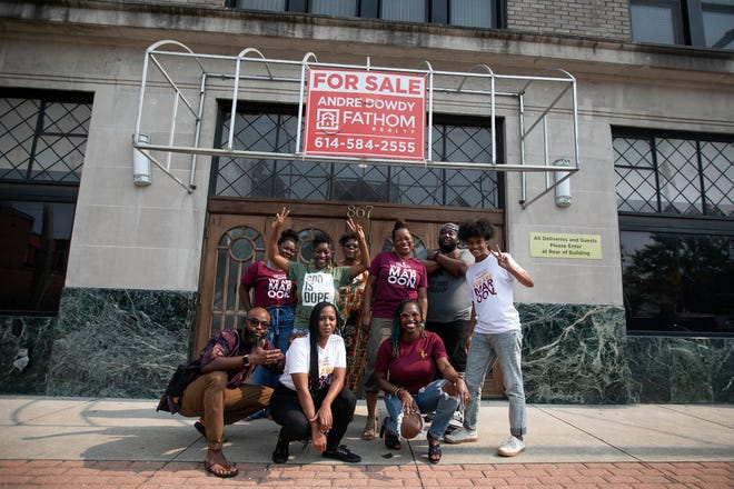 Members of Maroon Arts Group gather for a photo and to celebrate their purchase of the Pythian building, which is owned by the York Masons and formerly was leased by the King Arts Complex.