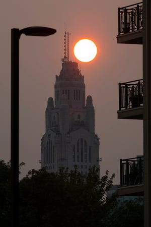 A hazy sunset — caused by smoke from wildfires out West — was evident Downtown on Tuesday.