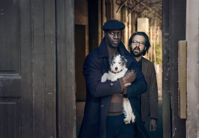 """Omar Sy, left, and Antoine Gouy in """"Lupin"""" on Netflix. (Emmanuel Guimier/Netflix/TNS)"""