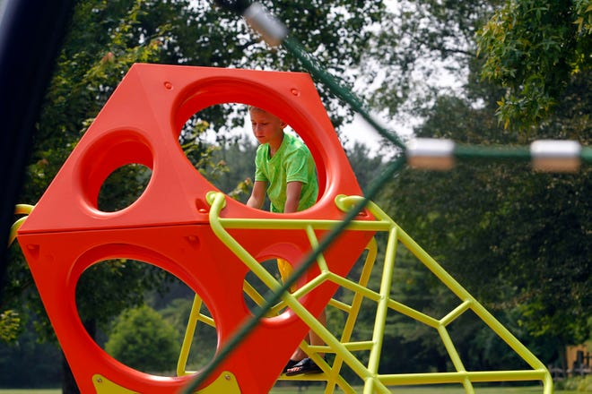 Damien Welty, 7, plays on the new playground equipment at Woodside Green Park, 213 Camrose Court in Gahanna, on July 20. Funding for the new equipment came from Issue 12, which voters approved in May 2019, raising the city's income-tax rate from 1.5% to 2.5% and the credit from 83.33% to 100% for those who pay municipal taxes elsewhere.