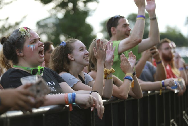 Fans cheer for British musician, Bishop Briggs, at the River Stage at the WonderBus Music & Arts Festival, Saturday, Aug. 17, 2019.