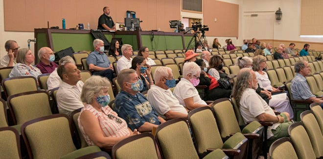 People listen during a city council meeting at the Mount Dora Community Building in Mount Dora on Tuesday, July 20, 2021. [PAUL RYAN / CORRESPONDENT]