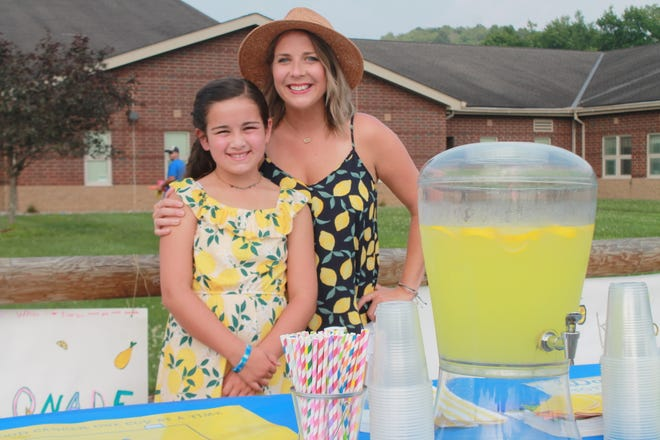 Student Emerson Lanning, 12, and teacher Amanda Swanson dressed the part to sell lemonade for the Alex's Lemonade Stand event hosted by CATS Camp students at Cambridge Intermediate School. They raised more than $1,500 for childhood cancer research.