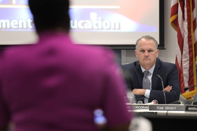 Florida Education Commissioner Richard Corcoran listens as Duval County Public Schools Superintendent Dianna Greene addresses the Board of Education on June 10.