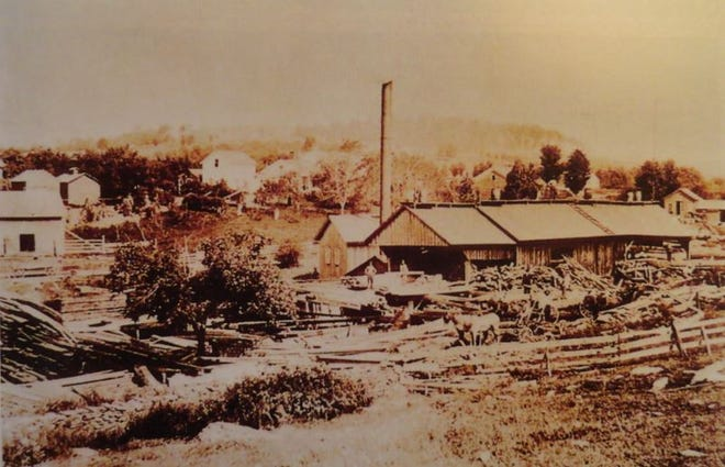 Boyd's Mills, Pa. 1870's- This is the steam saw mill built by Joseph Wood and Thomas Y. Boyd. The season this picture was taken, the firm had nearly three million feet of lumber on the banks of the river. At least a million and a half still remained on the bank. From left to right, in rear: blacksmith shop, the school (white), store and post office; the home of Thomas Boyd (the large, white house). In the background on the hill is the home of Joseph Wood. The steam saw mill is in front. (Pictorial History of Wayne County, Pa.)