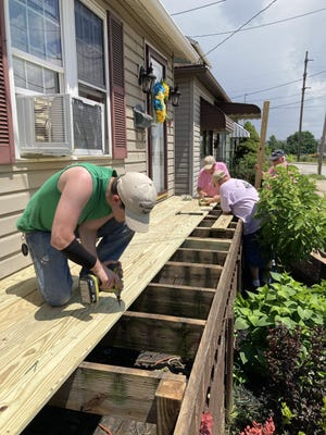 Volunteers from The Carpenter's Project recently worked on 14 homes during the week of July 12 during the project's 20th year.