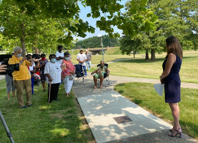 """Independence Mayor Eileen Weir and former residents of the """"Neck"""" gathered Tuesday to dedicate a plaque in McCoy Park that marks the former neighborhood, which was dismantled in the 1960s as part of urban renewal. Some former residents shared their memories of growing up in the neighborhood that had been across from the Truman Library. The plaque reads: """"The 'Neck' was interracial neighborhood comprised of working class African Americans and whites since it was platted in the 19th century. The neighborhood thrived in the 20th century and some of its residents worked in the homes of Independence's prominent residents. In 1962, the Land Clearance for Redevelopment Authority determined that this area was blighted and launched an urban renewal project that resulted in the clearance of the homes. Despite attempts by local advocates to stop the destruction of the neighborhood, McCoy Park and Bess Truman Parkway are all that remain of this once vibrant interracial community."""""""