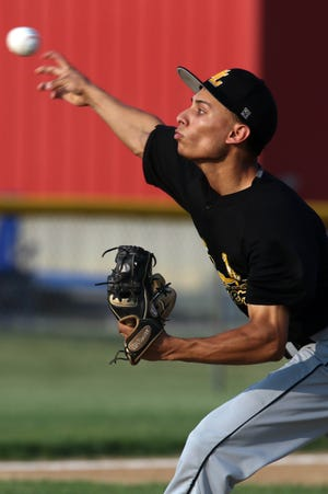 New London High School's Hecniel Rodriguez (13) delivers a pitch during their Class 1A substate final against Mount Ayr Tuesday July 20, 2021, at Oskaloosa.