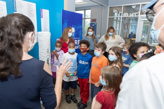 Children attend the donation of a UVC Lightforce cleaning device at the Boys & Girls Clubs of Bloomington's administration building adjoining its Ferguson Crestmont club.