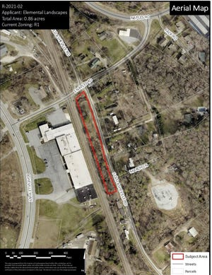 The Henderson County Board of Commissioners approved the rezoning of 0.86 acres of land from Residential One to Regional Commercial.