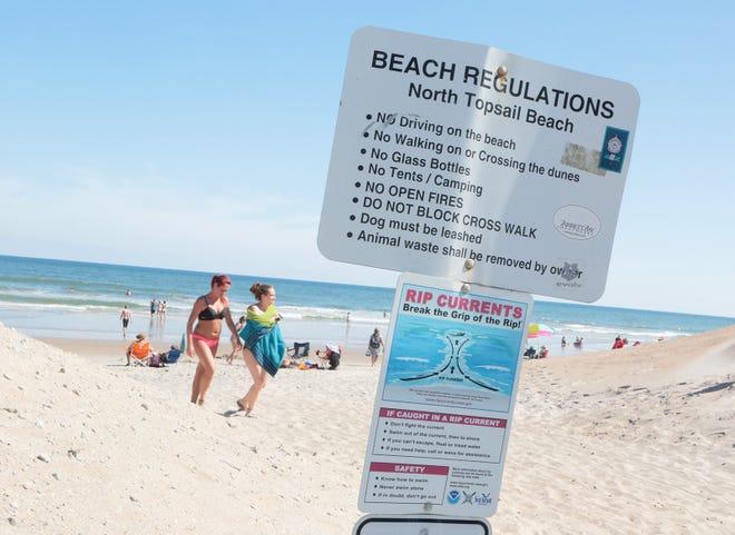 A sign at North Topsail Beach warns of rip currents.