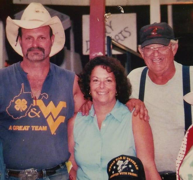 Ed Smolder, Lisa Smolder and Leo Rawson smile at the fair.