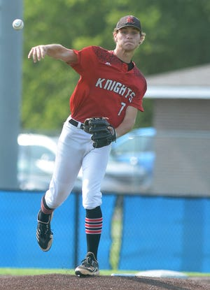 Newton Senior Knight pitcher Grif Davis makes a pickoff throw to first base duing play at Great Bend.
