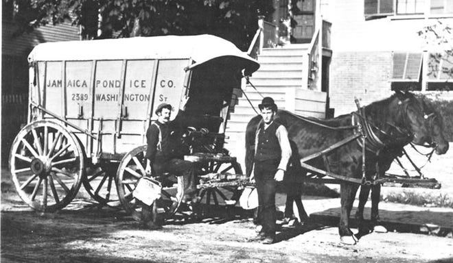 Two delivery men using ice tongs to hold blocks of ice cut to the proper size to fit into iceboxes in the early 20th century. To learn more, visit the Jamaica Plain Historical at www.jphs.org.