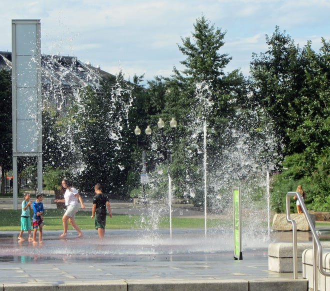 These kids cool off in one of the fountains in the Rose Kennedy Greenway on a hot summer day.