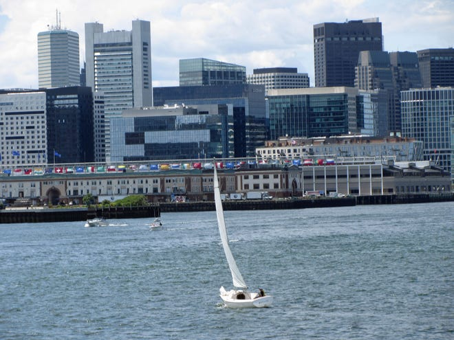A sailboat is on the water by Fisherman's Wharf on a great day.