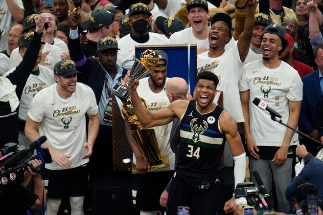 Milwaukee Bucks forward Giannis Antetokounmpo (34) holds up the MVP trophy after defeating the Phoenix Suns in Game 6 of basketball's NBA Finals in Milwaukee/