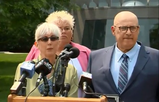 Ina and David Steiner, accompanied by their attorney Rosemary Scapicchio speak at a press conference in Boston on Wednesday.