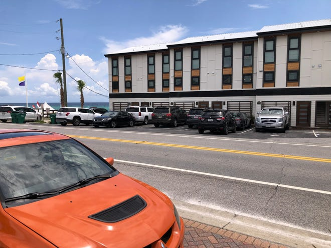 Cars fill the parking lot of a vacation rental condominium complex in Miramar Beach on Wednesday. A group of bed tax collectors in Walton County attended a Tuesday joint meeting of the Tourist Development Council and Board of County Commissioners with questions and comments about an array of tourism-related issues.