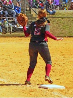 An Oak Ridge High School softball player fields the ball during a game in 2017.