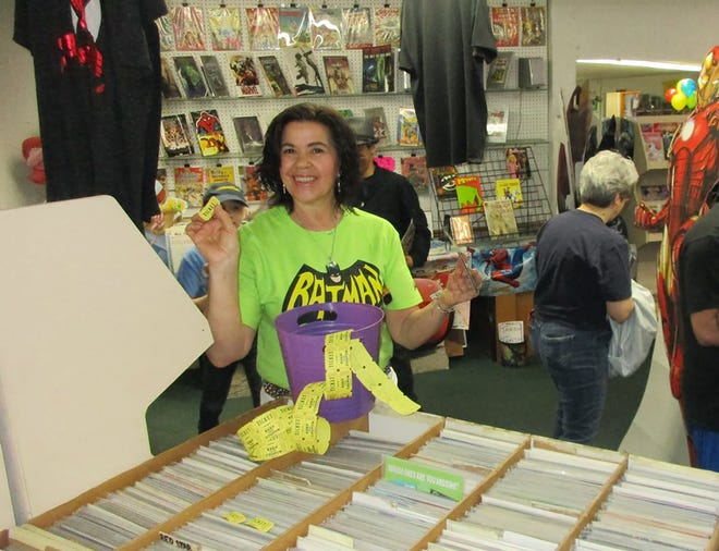 Ravenswood Comics owner Janine Valeriano draws lucky prize winners on Free Comic Book Day in May 2018. The New Hartford shop will again host the annual event from 10 a.m. to 4 p.m. Aug. 14.