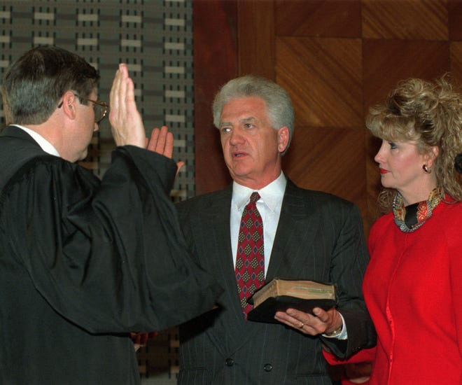 Former Oklahoma County Commissioner Earl Rooms is pictured being sworn in in 1997.