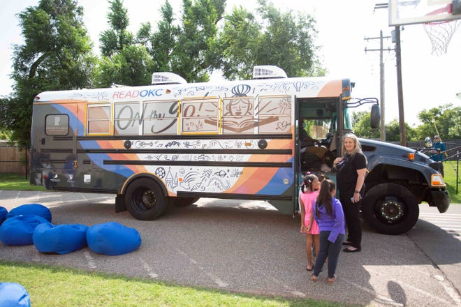 Oklahoma City Public School's On the Go mobile book bus program provides books that children can keep.