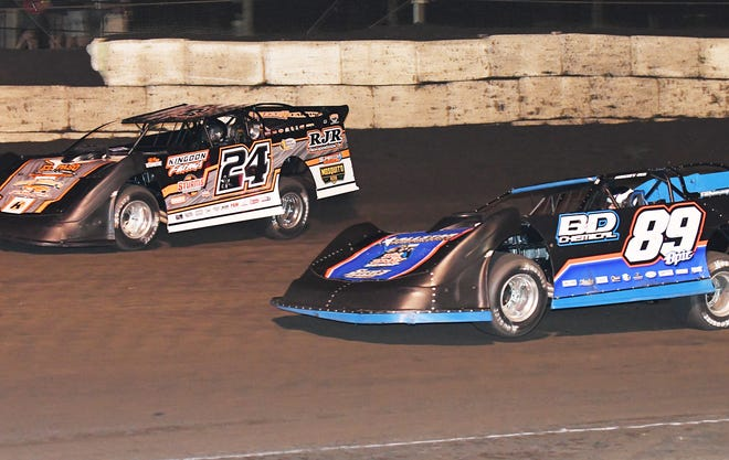 Ryan Unzicker (24) races with Mike Spatola at Fairbury. Both drivers will poise as contenders when the Prairie Dirt Classic takes place next weekend.