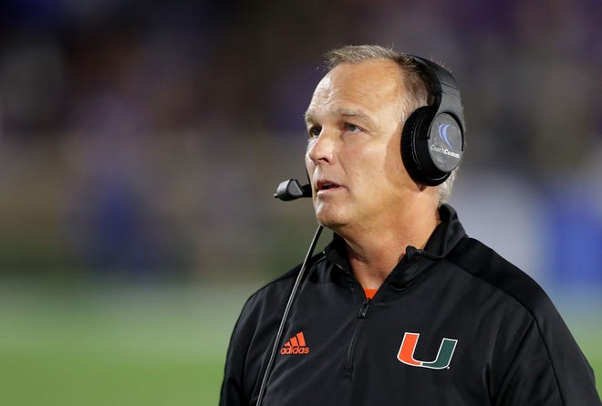 As head coach of the Miami Hurricanes, Mark Richt watches the team play the Duke Blue Devils in Durham, North Carolina, in September  2017. Richt revealed earlier this month that he's been diagnosed with Parkinson's disease. Photo by Streeter Lecka/Getty Images