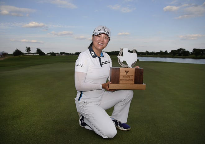 South Korea's Jin Young Ko holds the winner's trophy after her victory in the LPGA Volunteers of America Classic July 4 in The Colony, Texas,