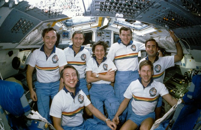 Woody Spring, bottom right, orbiting in the Space Shuttle Atlantis in 1985. In the back row, from left, are fellow crew members Jerry L. Ross, Brewster Shaw Jr., Mary L. Cleave, Bryan D. O'Connor and Rodolfo Neri. At bottom left is Charles D. Walker.