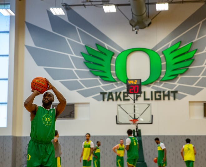 Tajuan Porter, left, shoots free throws Tuesday in the Matthew Knight Arena practice gym. Porter is one of 12 Oregon men's basketball alums on the Always Us team playing in The Basketball Tournament starting Sunday.