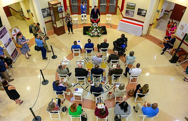 St. Johns County Commissioner Jeremiah Blocker speaks during a ceremony held in the rotunda of the county government administration building in St. Augustine on Wednesday to dedicate a time capsule to commemorate the 200th anniversary of the founding of the county.