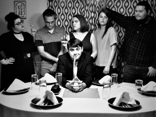 """The cast of the locally-shot independent film """"Sebastian's Dinner Party"""" poses for a portrait, with Darrin Sims seated and Victoria Lauren, left, Tarran Gill, Corinna Darr, Lizzy Anderson, and Zane Miller standing. It will have its premiere screening July 31, 2021, at the BK Club in Mishawaka."""
