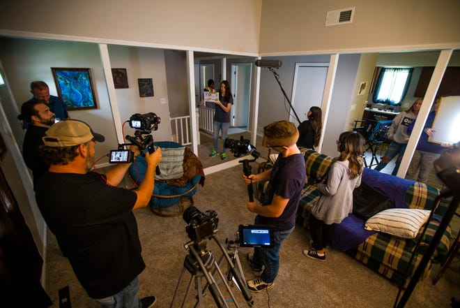"""Crews prepare for a take during filming of """"Hard Road to Happy"""" on Wednesday at a home in Mishawaka."""