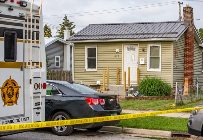 St. Joseph County Metro Homicide investigates a scene at 819 Burdette Street in Mishawaka on Wednesday. Two men were found dead inside the home.
