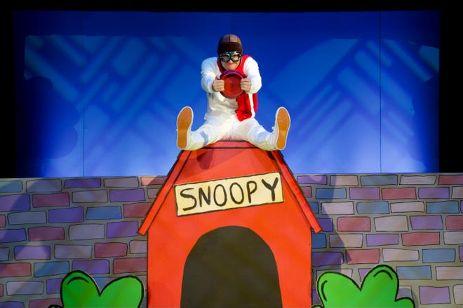 """Caleb Shaw plays Snoopy as the """"World War I flying ace"""" pilots his doghouse/airplane in Round Barn Theatre's production of """"You're a Good Man, Charlie Brown,"""" which continues through Aug. 22 at the Barns of Nappanee."""