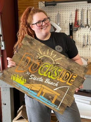 Michele Loudermilk, owner of the Board & Brush Creative Studio's upcoming Sarasota location, with one of her many creations.