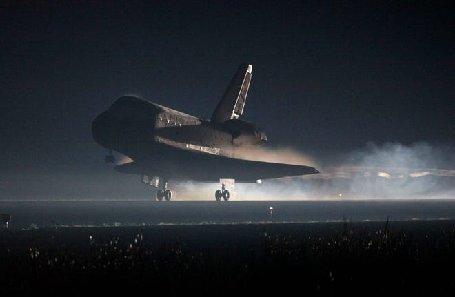 Space Shuttle Atlantis lands at the Kennedy Space Center at Cape Canaveral, Florida, on July 21, 2011. The landing of Atlantis marks the end of NASA's 30-year space shuttle program.