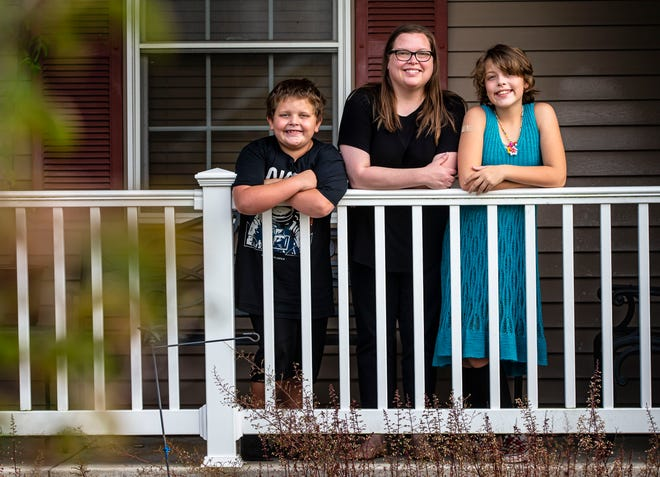 """Sarah Payne, center, supports her children, Holden, 9, left, and Abby, 12, returning to in-person learning this fall in the Ball Chatham School District, but does question the district's decision to make mask wearing optional. """"I support them being in school, but I don't want to take away the one thing that would protect them,"""" said Payne. """"It just seems super risky."""" [Justin L. Fowler/The State Journal-Register]"""