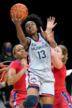 UConn's Christyn Williams goes up for a shot during a win against DePaul last season in Chicago.