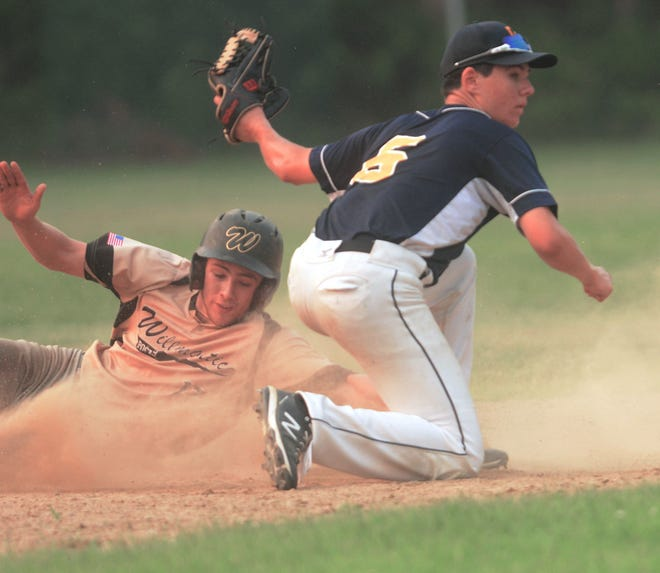 Jewett City's Sean Garvin tags out Willimantic's Jack Valliere trying to steal second Tuesday during their American Legion game in Griswold.