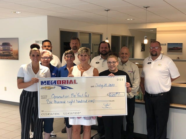 Memorial Highway Chevrolet of Windber presented a check to the Operation Beyoutiful Wednesday in the amount of $6,800. Memorial Highway and Operation Beyoutiful Partnered in the month of October. For each car sold in October, a donation was made to the organization. Operation Beyoutiful is a nonprofit organization that provides wigs to women with hair loss because of various medical conditions. Pictured from left to right are: Crystal Wagner, Nygel Saunders, Betty Flook, Loretta Myers, Roy Shaulis Andi Palmer, John Beskid, Danielle Rager, Gus Palmar and Jon Kiser.