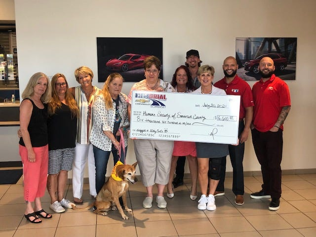 """Memorial Highway Chevrolet of Somerset County presented a check to the Humane Society of Somerset County on Tuesday in the amount of $6,600. Memorial Highway and the humane society partnered in the month of May — for each car sold in May, a donation was made to the organization. The Humane Society of Somerset County brought animals for adoption to the dealership each weekend in the month of May. All animals were adopted. The dealership also collected supplies for the human society. The dealership is also sponsoring an event Sept. 25 — the """"Fast and Furriest"""" car show at the Somerset dealership. Pictured from left to right are: Mary Blank, Beth Barron, Lisa Downey, Zeke, Linda Koontz, Scotty Turner, Tammy Blalock, Andi Palmar, Andre Palmer and Luis Maquilon."""