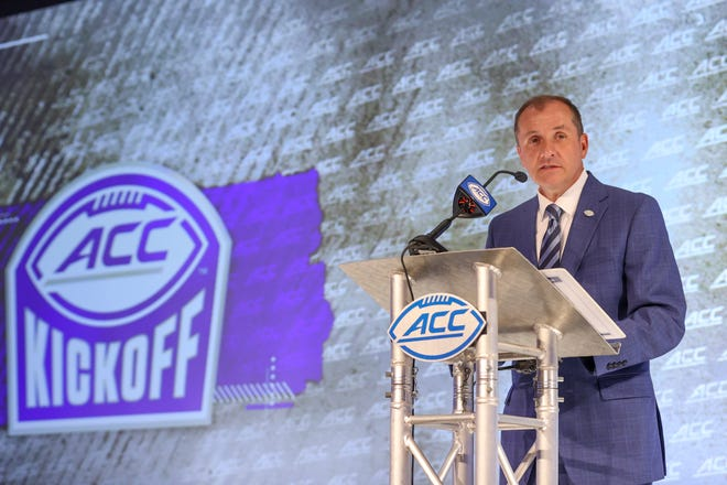 Atlantic Coast Conference commissioner Jim Phillips speaks during the NCAA college football ACC media days in Charlotte, N.C., Wednesday, July 21, 2021. (AP Photo/Nell Redmond)