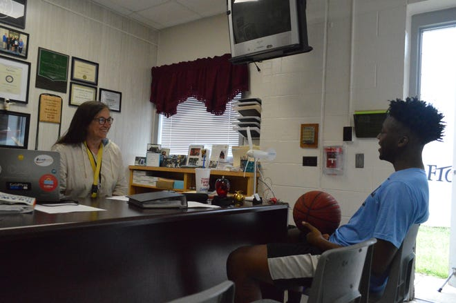 Denise Renfro, left, and Ty'Rell McLucas formed quite the bond during their time at Douglas Byrd High School. The recent Byrd graduate is set to attend UNC on a full academic scholarship.